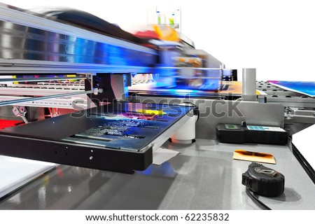 Working industrial large format UV inkjet printer for printing on big sheets of plastic or billboards isolated over white - stock photo