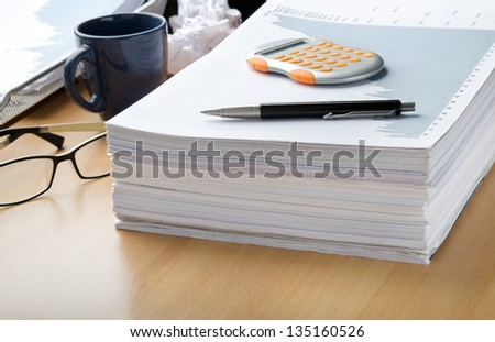 Working late and short deadlines at office - stock photo