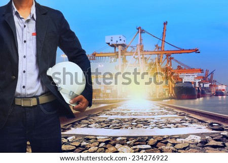 working man in port shipping transport and train land logistic use for transportation industry background - stock photo