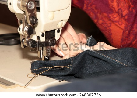 working mechanism of professional sewing machine - stock photo