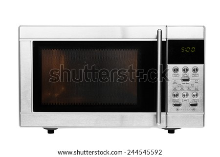 Working microwave made of shiny metal isolated on a white background