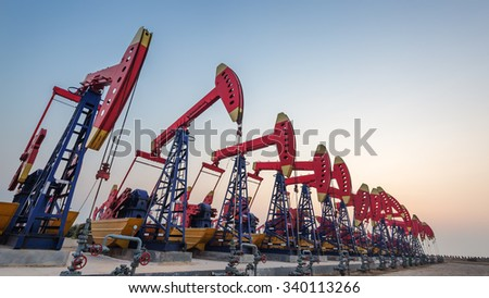working oil-rig of oilfield day and night  - stock photo