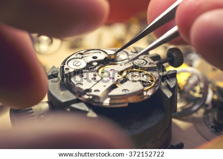 Working On A Mechanical Watch. - stock photo
