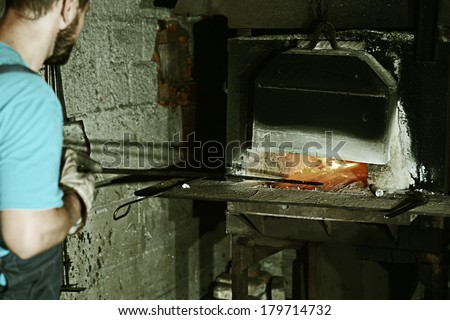 Working on iron stove factory - stock photo