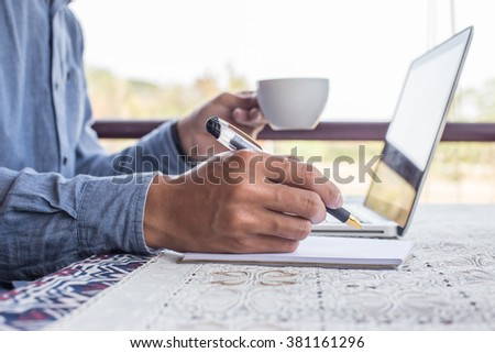 working on laptop, close up of hands of business man - stock photo