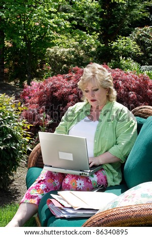 Working on the laptop outside - stock photo