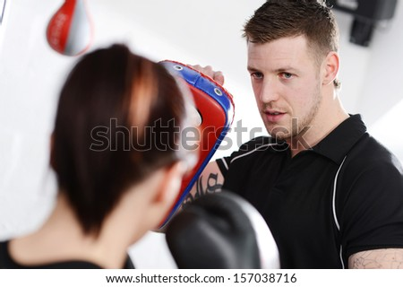 Working out with mitts or gloves and pads