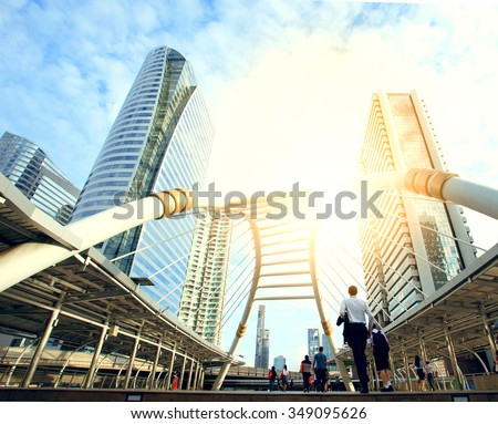 working people at bridge link between mrt and bts mass transportation in heart of bangkok newly modern important land mark of city life in bangkok thailand color process in blue vibrant tone - stock photo