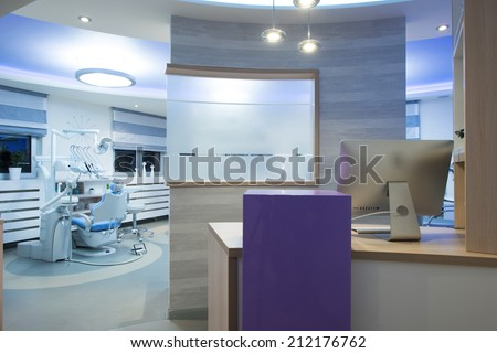 Working place - table with computer in dental clinic - stock photo