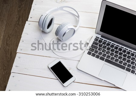 Working place, white headphones