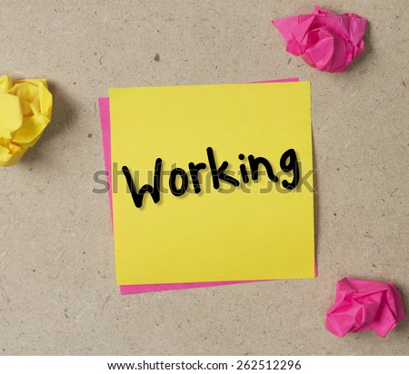 Working post on sticky note - stock photo