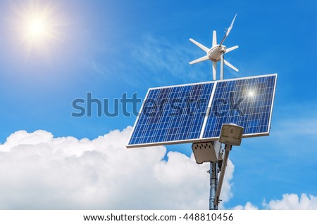 working solar panel with windmill under the sun