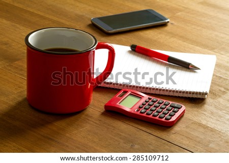 Working, taking notes and doing calculations - stock photo