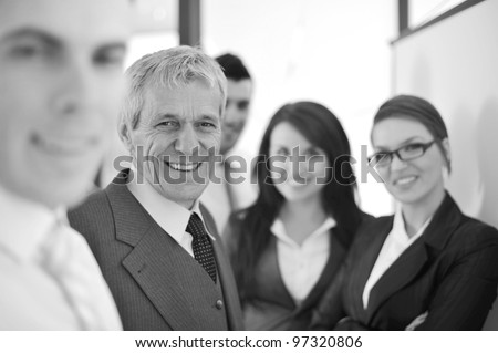 Working team in front of a whiteboard - stock photo