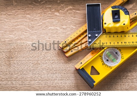 Working tools of measurement on oaken wooden board construction concept  - stock photo