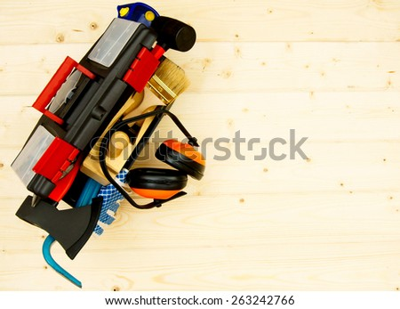Working tools. Tools in a box on a wooden background. - stock photo