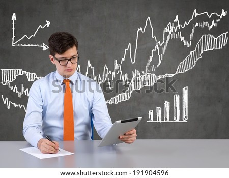 Working trader and market bar-chart. - stock photo