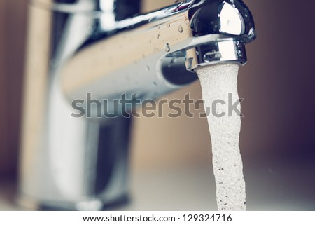 working water tap - stock photo