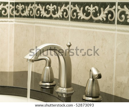 Working water tap - stock photo