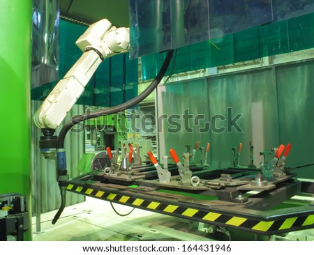 Working welding robot in factory - stock photo