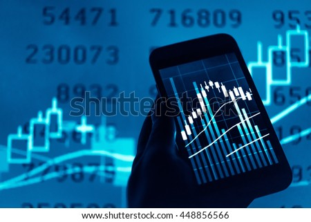 Working with digital tablet computer and smart phone with digital business strategy layer effect and the digital chart. Blue Tone.