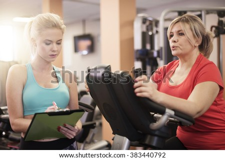 Working with professional trainer gives better result  - stock photo
