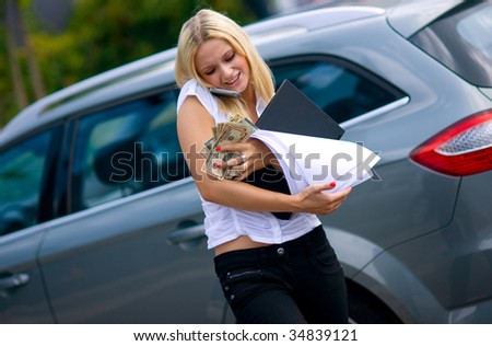 working woman with laptop phone money and documents on the street in trouble - stock photo