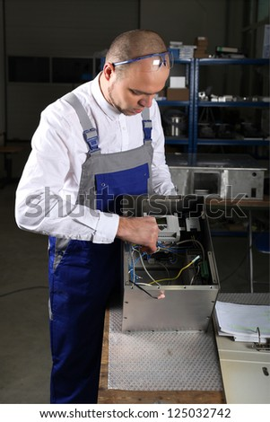 workman in blue overalls - stock photo