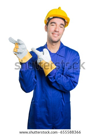 Workman pointing on white background