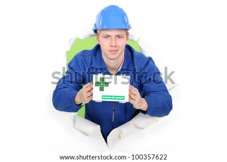 Workman showing first aid kit - stock photo