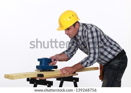 Workman using a power tool - stock photo