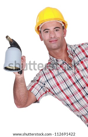 Workman with a blowtorch - stock photo