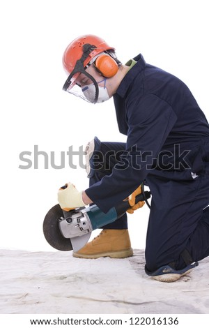 workman with angle grinder wearing full protective clothing - stock photo
