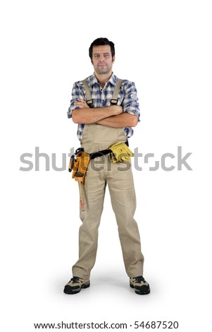 Workman with arms crossed on white background - stock photo