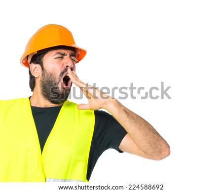 Workman yawning over isolated white background - stock photo