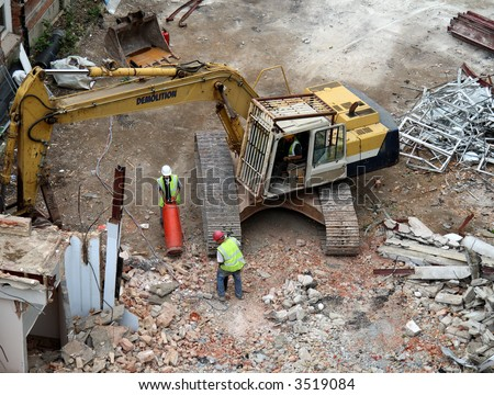 Workmen and Machinery on a Demolition Site - stock photo