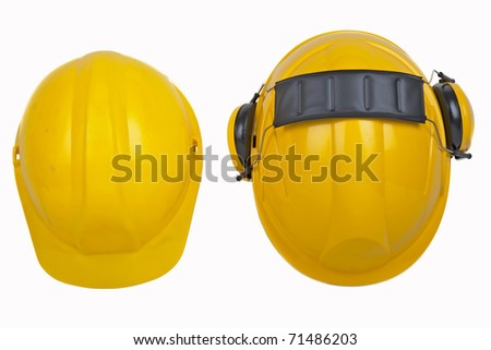 Workmens safety hats isolated. One hardhat is new the other in used condition - stock photo