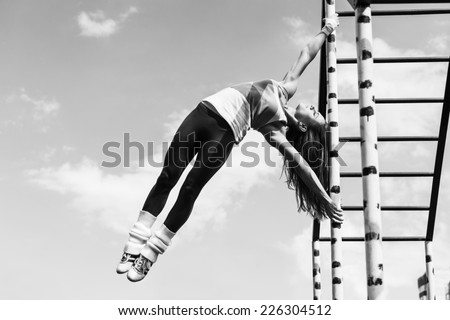 Workout girl with sky on background - stock photo