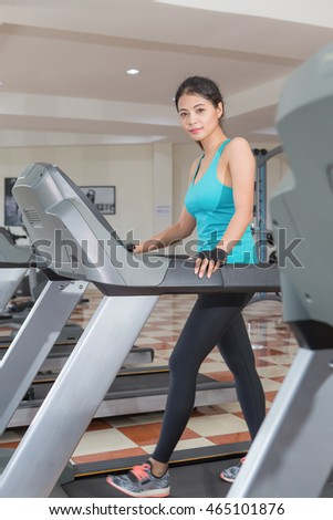 workout on a treadmill at gym . soft focus