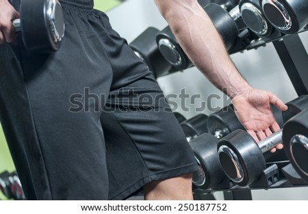 Workout with dumbbells at gym. - stock photo