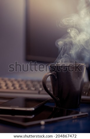 Workplace at office with tablet and laptop - stock photo
