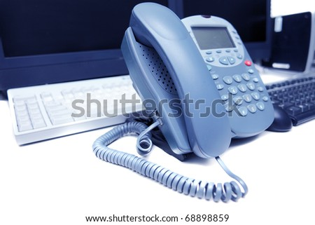 Workplace business person in the office. Phone and computer. Isolated over white - stock photo