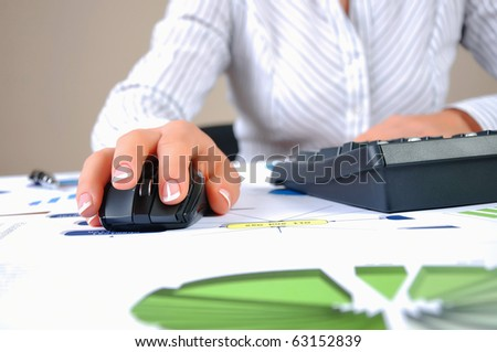 Workplace businessman. Charts, securities, charts on your desktop - stock photo