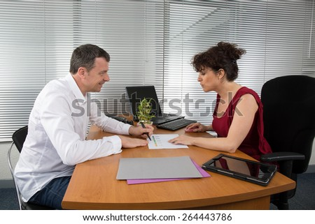Workplace businesspeople working together in boardroom - stock photo