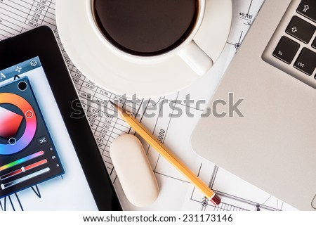 Workplace Designer, laptop, tablet and project with a pencil - stock photo