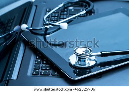Workplace doctor with a stethoscope table laptop.
