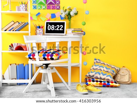 Workplace for teenager with table and chair - stock photo
