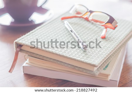 Workplace in coffee shop with pen and notebooks, stock photo - stock photo