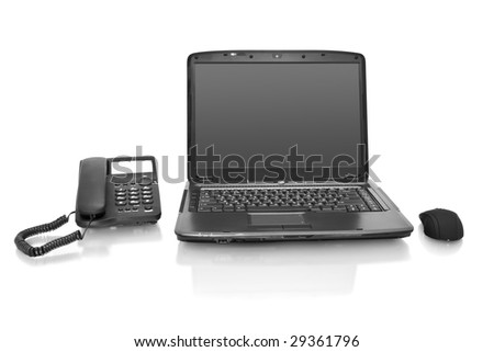 workplace. laptop with telephone isolated on white - stock photo