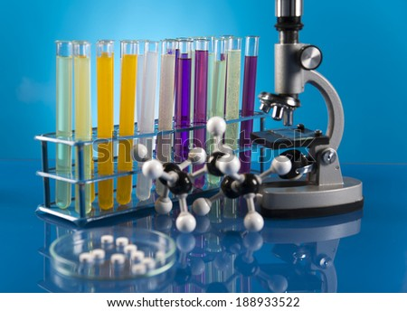 Workplace modern laboratory for molecular biology test on blue background - stock photo